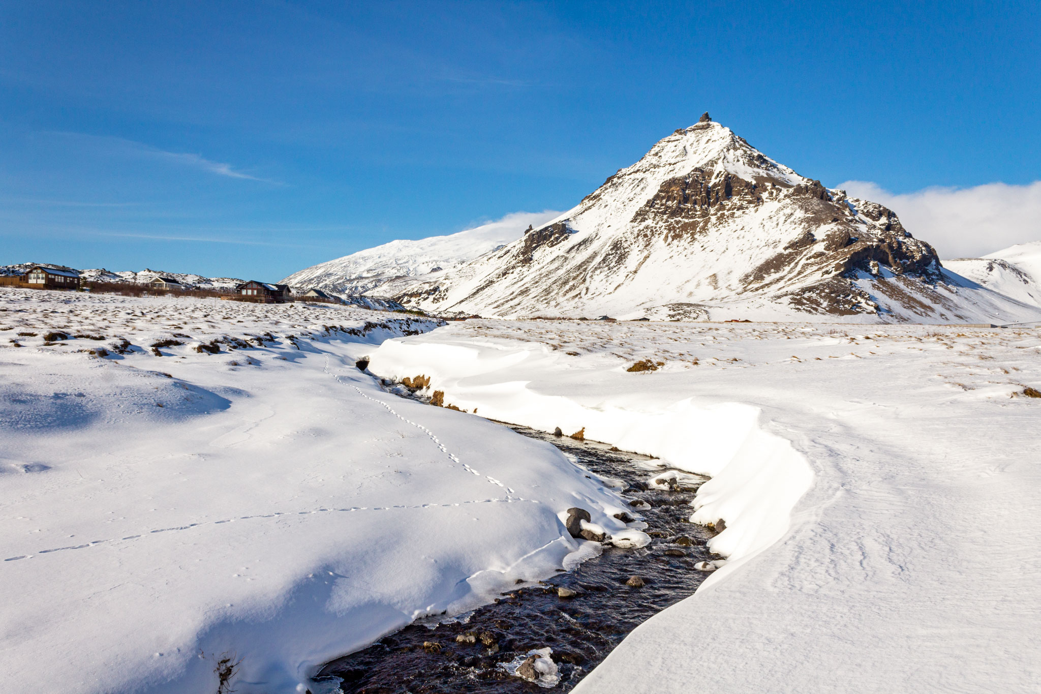 why visit iceland arnastapi winter snow